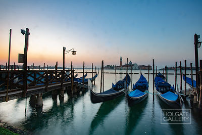 A long exposure gives movement to the gondolas in the foreground, with San Giorgio Maggiore beyond.