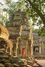 A lone monk at  the Buddhist temple of Ta Prohm within the Angkor Wat complex in Cambodia.