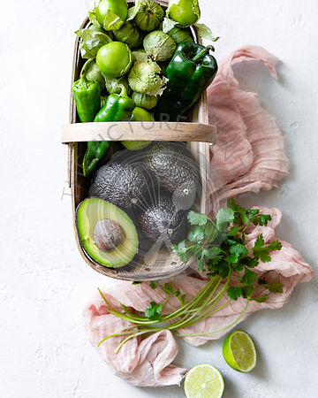Tomatillo salsa ingredients in a basket.