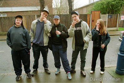 Teenagers from Dave Adams house, a childrens' home in Tower Hamlets drinking alcopops & smoking cannabis. © David Hoffman pho...
