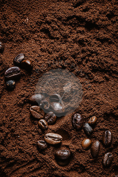 Coffee beans on ground coffee