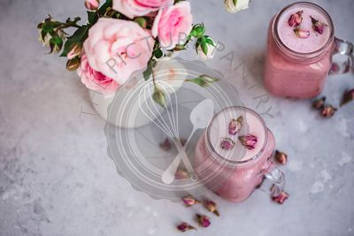 Pink raspberry smoothies in glass jars