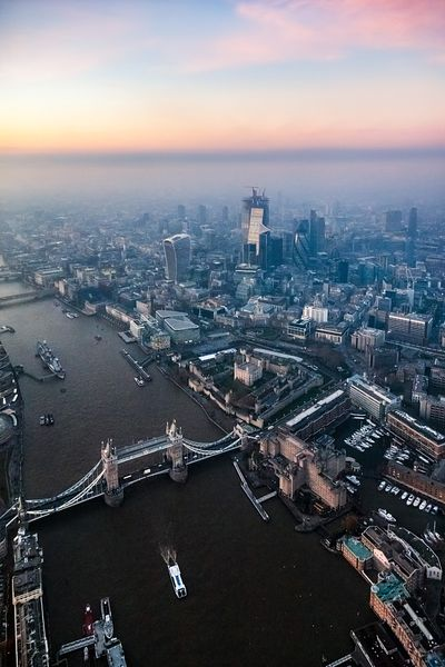 Aerial view of the Tower bridge and the City at dusk