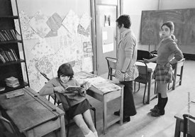 #75031  Decorating the walls with pages from a wallpaper catalogue, Liverpool Free School, Liverpool  1971.  Also known as th...