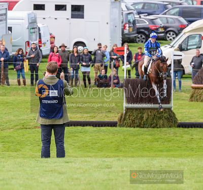 Fence judge filming jumping of a fence - Land Rover Burghley Horse Trials 2019