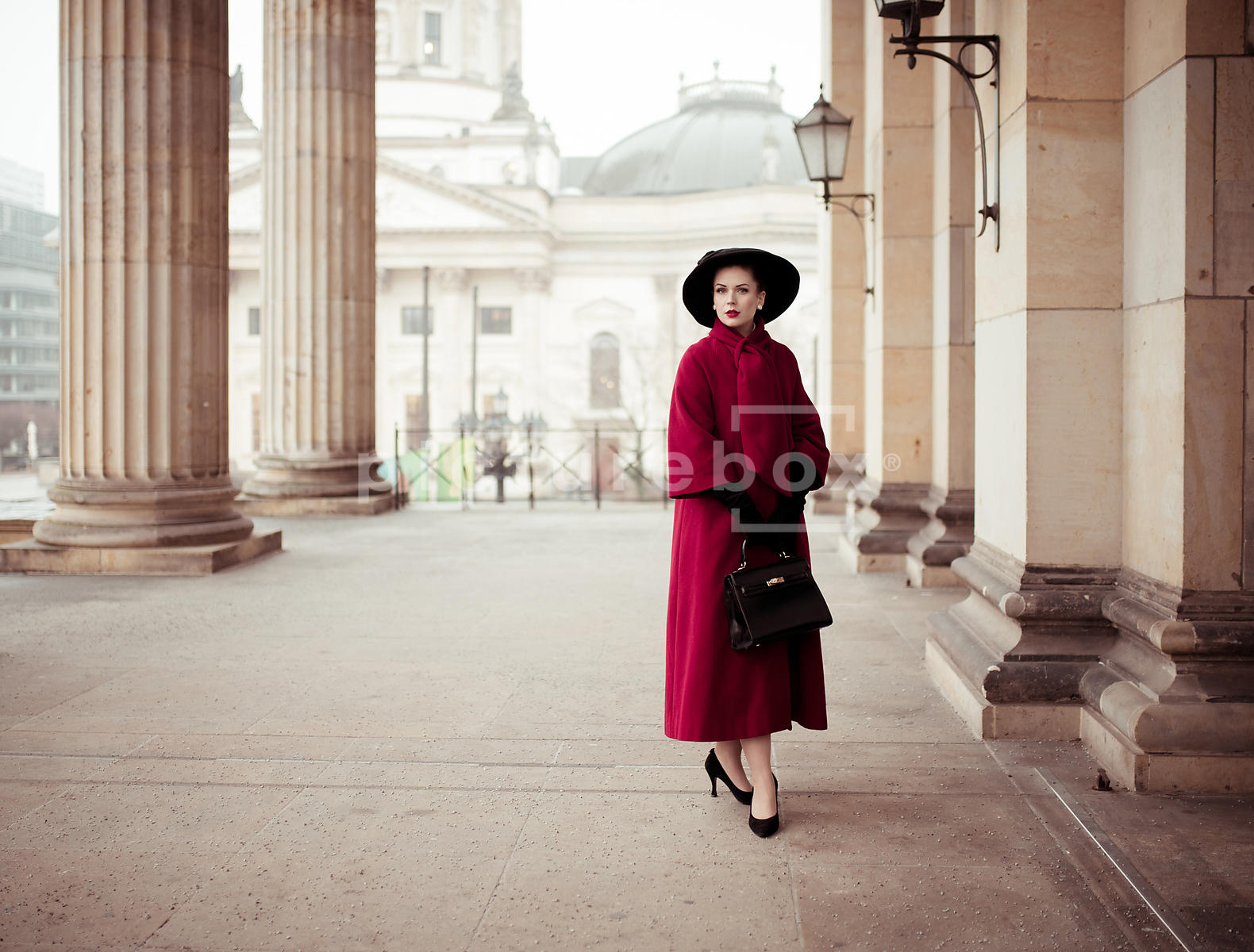 A vintage woman in a red coat.
