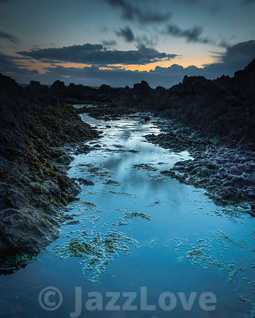 Twilight on rocky beach in Freshwater West, Pembrokeshire, South Wales,UK.
