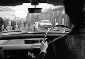 #83603,  Teacher driving to school in the morning, Whitworth Comprehensive School, Whitworth, Lancashire.  1970.  Shot for th...