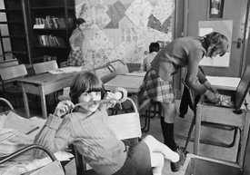 #75028  Decorating the walls with pages from a wallpaper catalogue, Liverpool Free School, Liverpool  1971.  Also known as th...