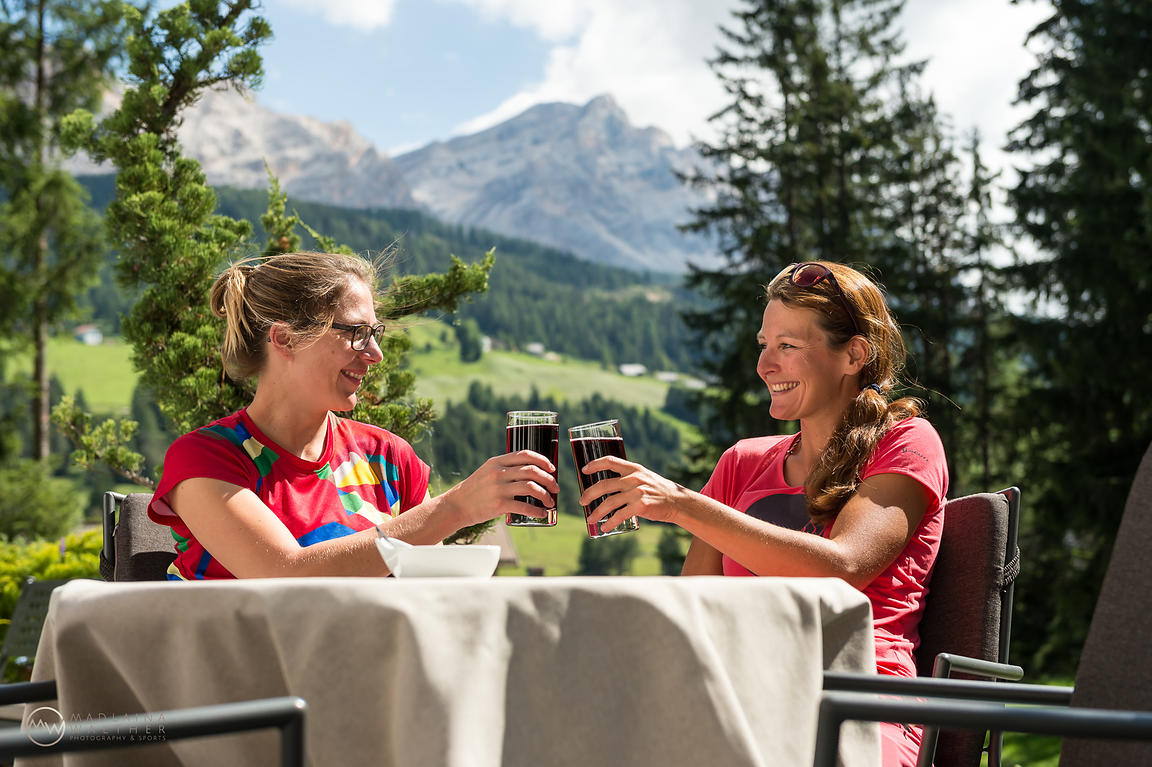 Cheers after a lovely mountain bike tour in the Dolomites. Shot for TrailXperience.