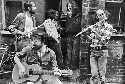 A group, of squatters playing in the courtyard of Fieldgate Mansions, Whitechapel in 1975.