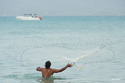Fisherman throwing a cast net