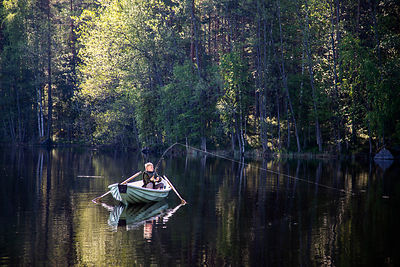 Boy fishing in Linnansaari National Park