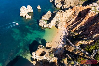 Drone view of Praia do Camilo beach, Algarve, Portugal