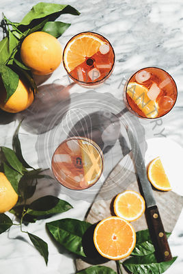 Aperol Spritz cocktail in glasses with oranges, top view