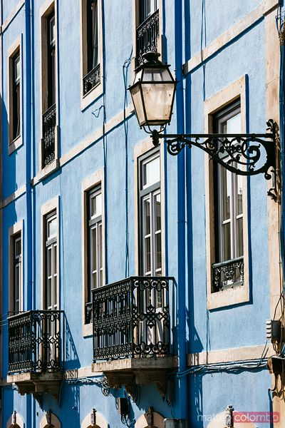 Blue house with windows and balconies, Lisbon, Portugal