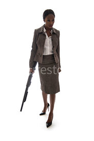 A woman, walking, holding a gun – shot from eye level.