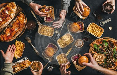 Lockdown fast food dinner with burgers, sandwiches, fries and beer