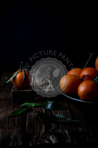 Clementines with leaves dark photography