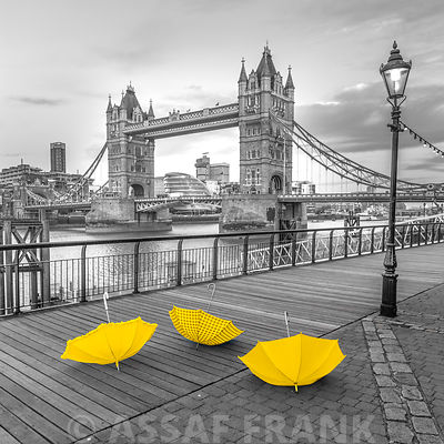 Colorful umbrellas on promenade near Tower bridge, London, UK