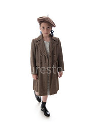 A 1940's child evacuee, in a big coat – shot from eye level.