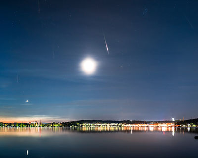 11 Perseid meteors above the city of Lahti in southern Finland on August 14th 2020. Composite.
