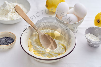 Mixing butter and sugar with wooden spoon