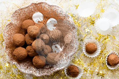 Homemade chocolate truffles coated in cocoa.
