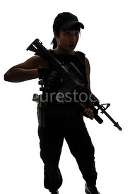 A silhouette of a tough woman, holding a rifle – shot from eye level.
