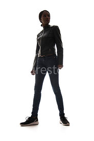 A tough woman, in a leather jacket, in semi-silhouette – shot from low level.