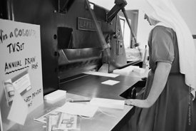 #120102, One of the Sisters operating the print machine in the printworks at Ladywell Convent, Godalming, the Motherhouse of ...
