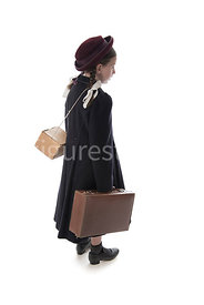 A 1940's child evacuee, in a big, coat, carrying a suitcase – shot from eye level.