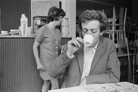 #74866,  Cornelius Cardew (1936-1981), avant-garde musician and composer, in his favourite cafe, Fitzrovia, London.  3rd July...