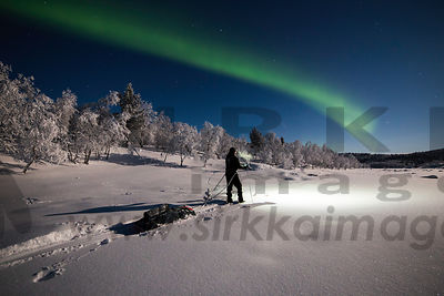 Hiker and the northern lights