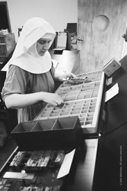 #120105, One of the Sisters type-setting in the printworks.  Ladywell Convent, Godalming, is the Motherhouse of an Internatio...