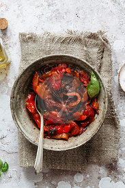 Roasted red peppers into a rustic bowl