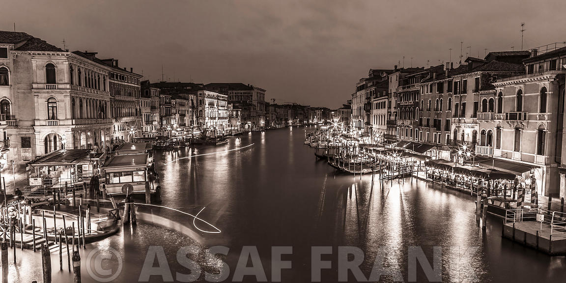 The grand canal from the Rialto bridge at night, Venice, Italy