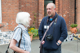 #74615,  Hylda Sims, ex-pupil and ex-parent chatting to Steve Fawdry, parent and editor of the Summerhill Newsletter, at the ...