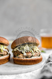 Turkey burger, on whole wheat bun with apple cabbage slaw