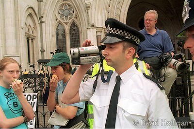 YZ76/3 Police video supporters of GenetiX Snowball protesters outside High Court, London while Monsanto argue that GM campaig...