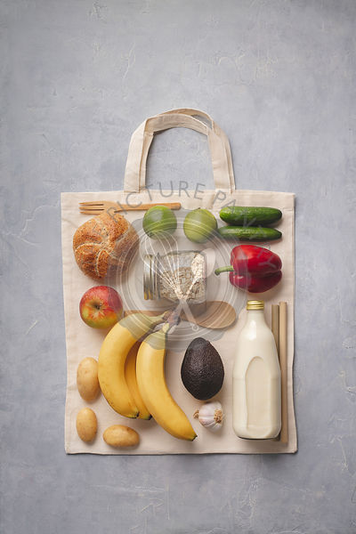 Zero waste concept. Fresh organic food on the cotton eco bag, flat lay