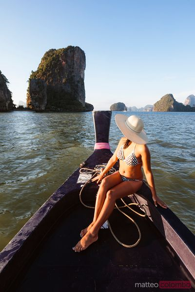 Woman looking at James Bond Island, Phang Nga bay, Thailand