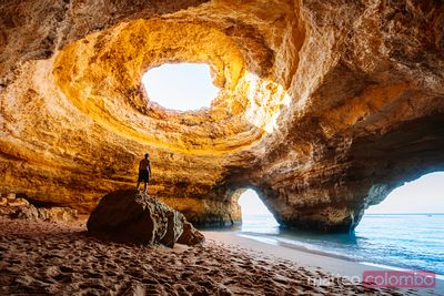 Man standing on rock, Benagil cave, Algarve, Portugal