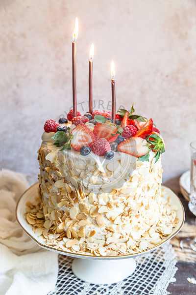 Birthday cake with mascarpone cream and berries.