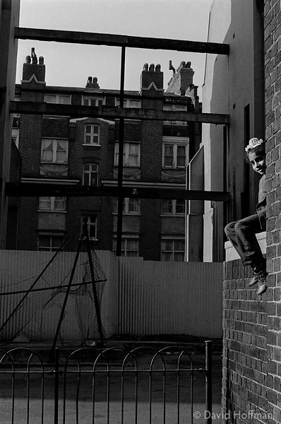 A21-37 Child playing in tenement block courtyard, Whitechapel or Wapping, around 1972.