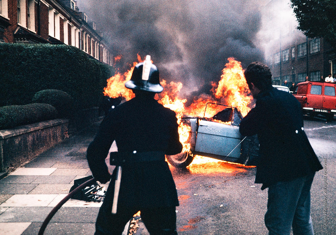 #125155  Three-wheeler car with a fibreglass body caught fire while the owner was working on it, Tooting Bec, London.  1972.