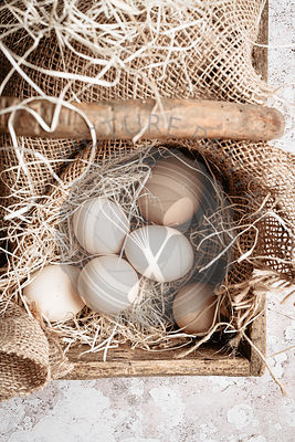 Rustic eggs into a wooden basket