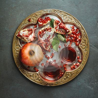 Pomegranate tea on dark background, flat lay