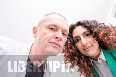 Two medical and healthcare professionals looking down into the camera- LGBTQ+ stock photos for diversity and inclusion
