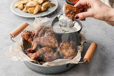 Chicken wings with dips and potatoes